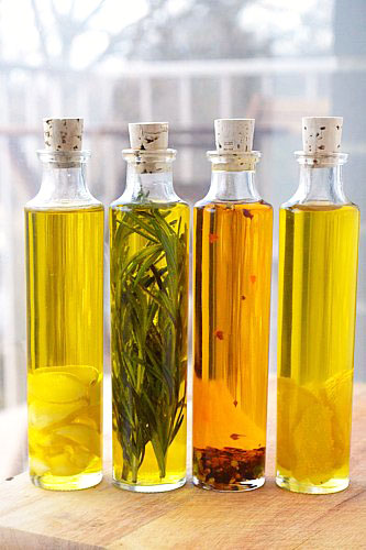 Flavored olive oil has much shorter shelf life that the traditional variety. Plan to use your flavored oil as soon as possible, and store in the fridge for up to one month. Oil will go bad without any change in smell or taste (but can cause you to get sick), so make sure to toss the unused oil after a month.